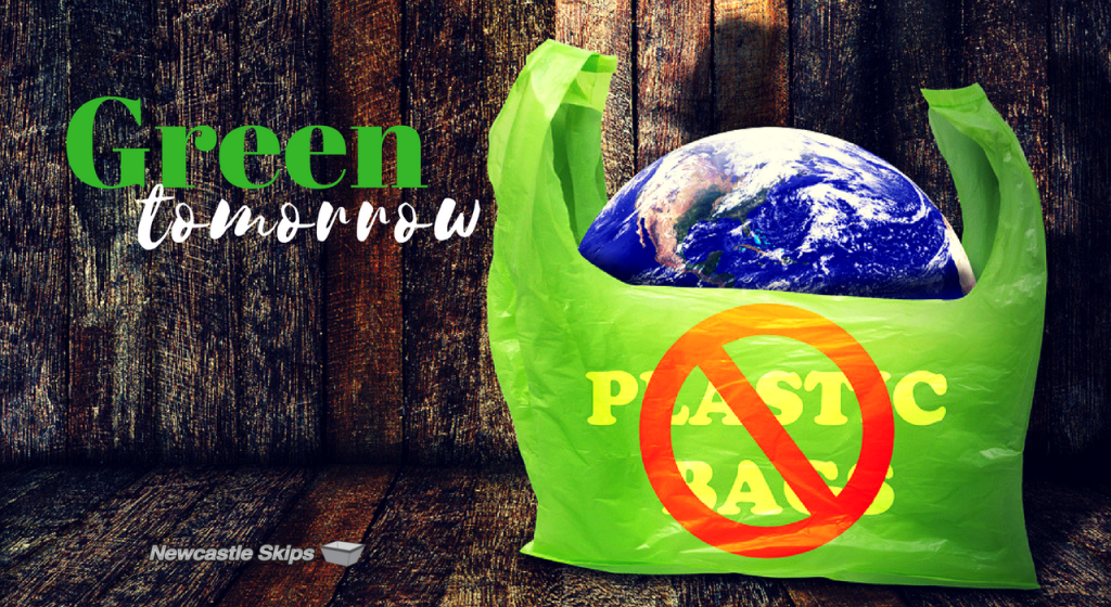 earth inside the green plastic bag with a sign of no plastic bags