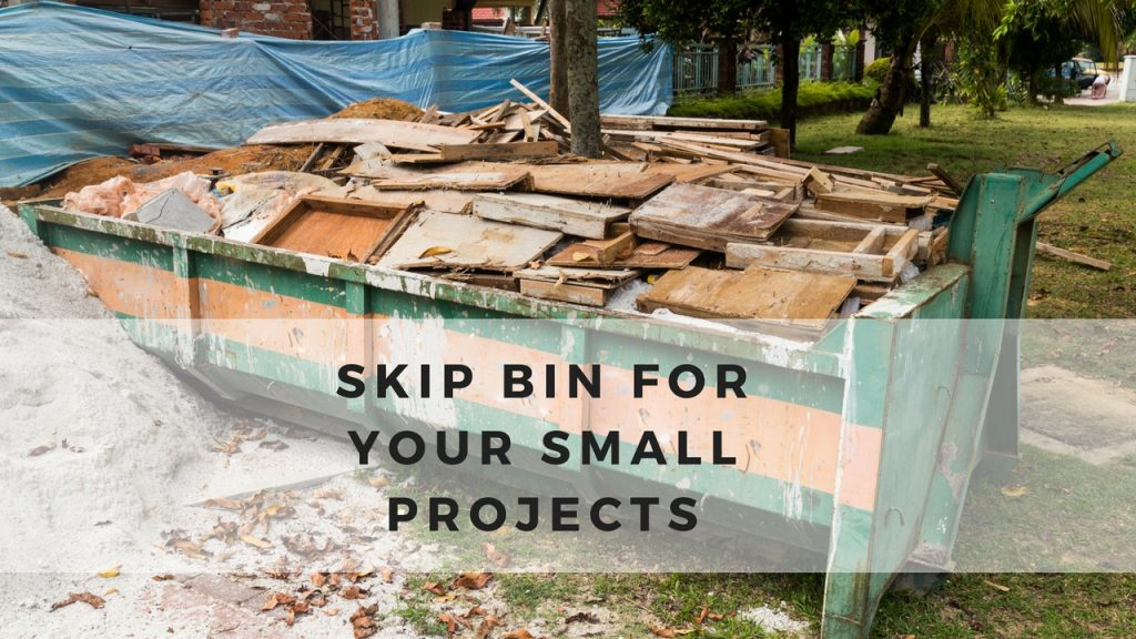 plywood's disposed in big green skip bins from housing material small project